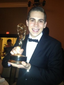 Brandon Launerts posing with his Emmy award.