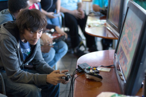 Student Hector Aponte playing a video game.
