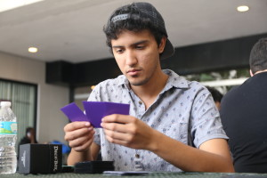 Student Isaac Cordero inspecting his cards.