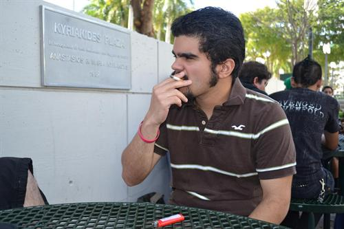 A student smoking on school grounds.