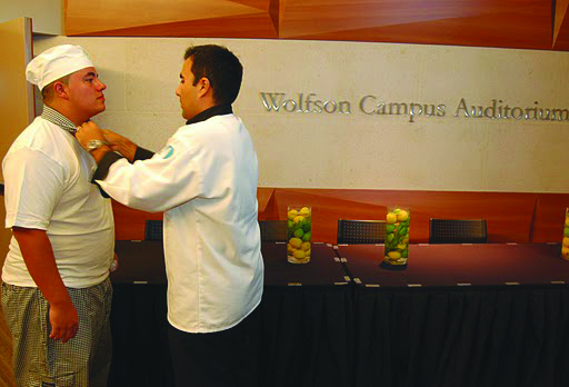 A student receiving his chef coat.
