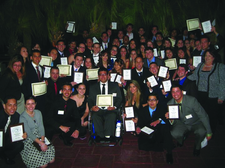 Phi Beta Lambda posing for a picture with their awards.