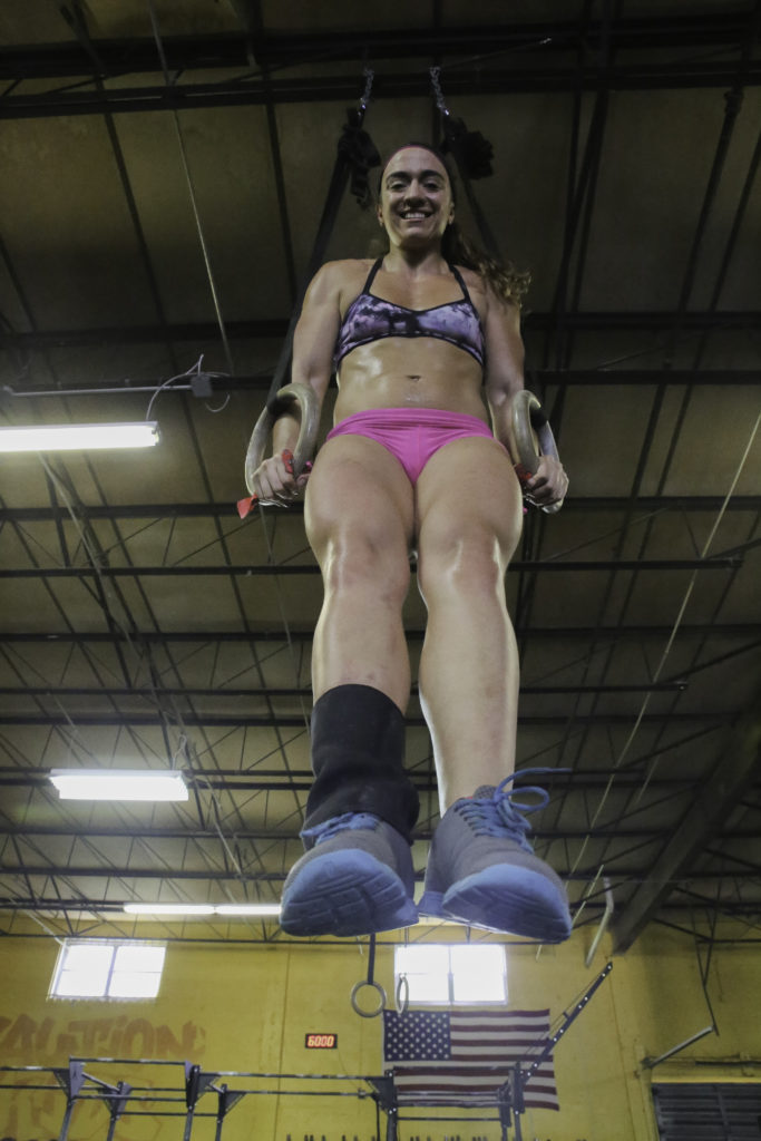 Laura Gonzalez Marin lifting herself up in the air while working out.