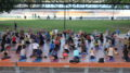 Participants practicing yoga at Bayfront Park.