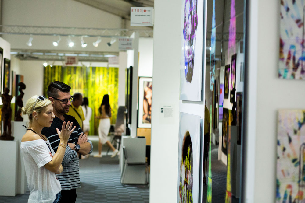 Art enthusiasts admiring some of the artworks.