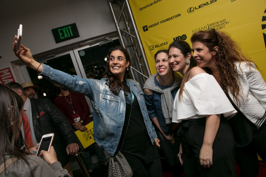 Fans taking a selfie with producer Nathalie Sar-Shalom.