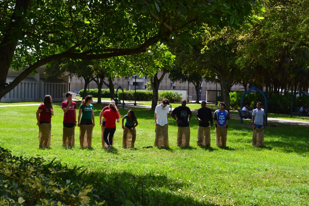 Students competing in a potato sack race.