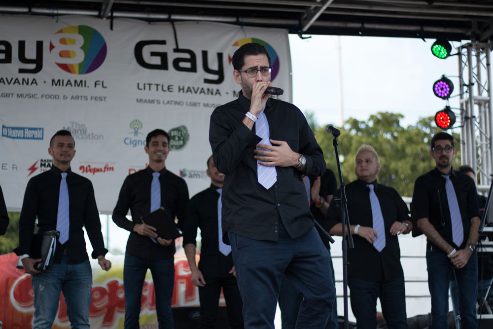 Adrian Toca of the Miami Gay Men Chorus performing on stage.