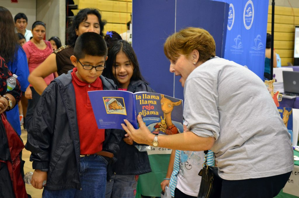A faculty member reading to children.