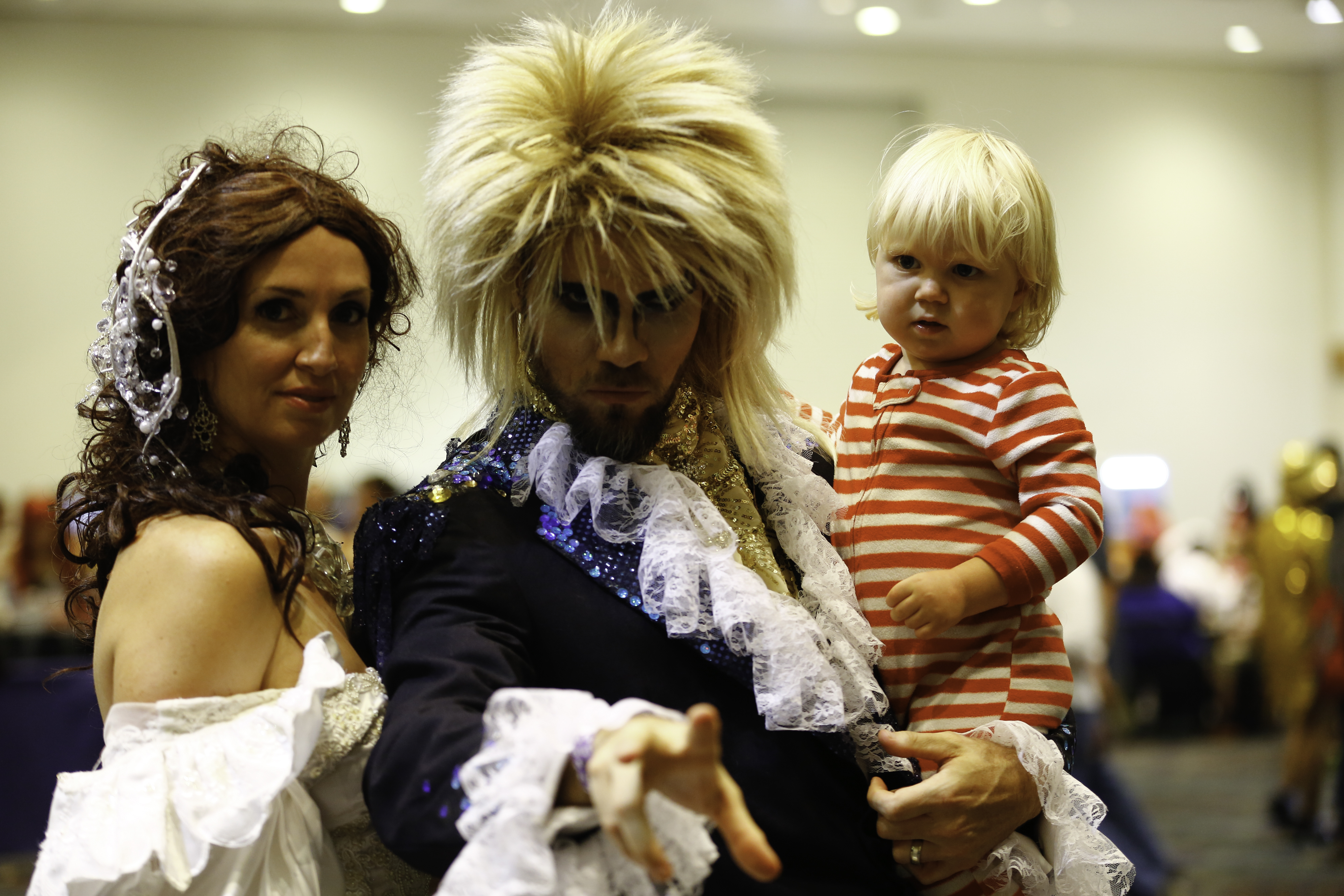 A family dressed as Sarah Williams, Jareth the Goblin Kind and Toby from Labyrinth.