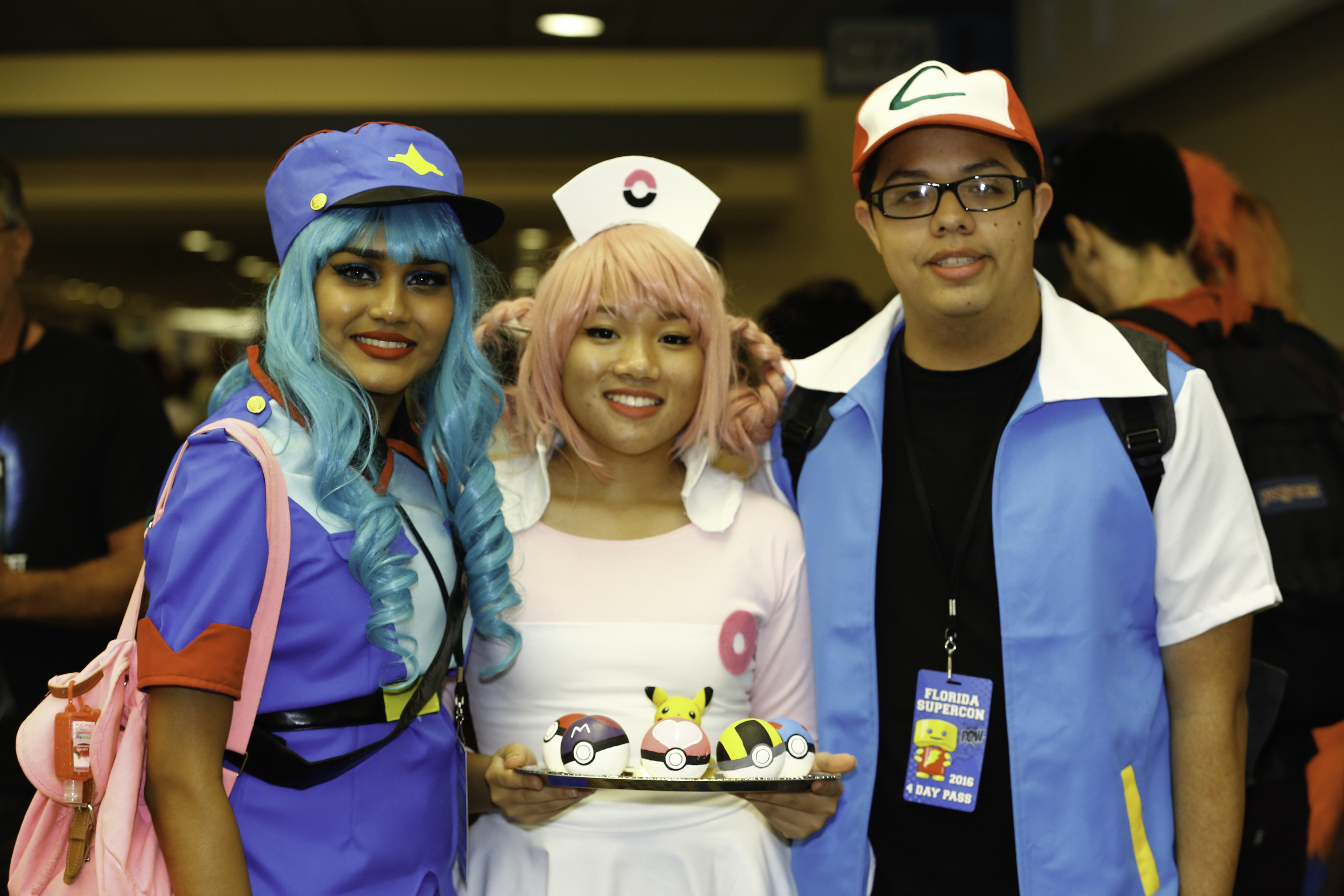 Cosplayers dressed as characters from Pokemon.