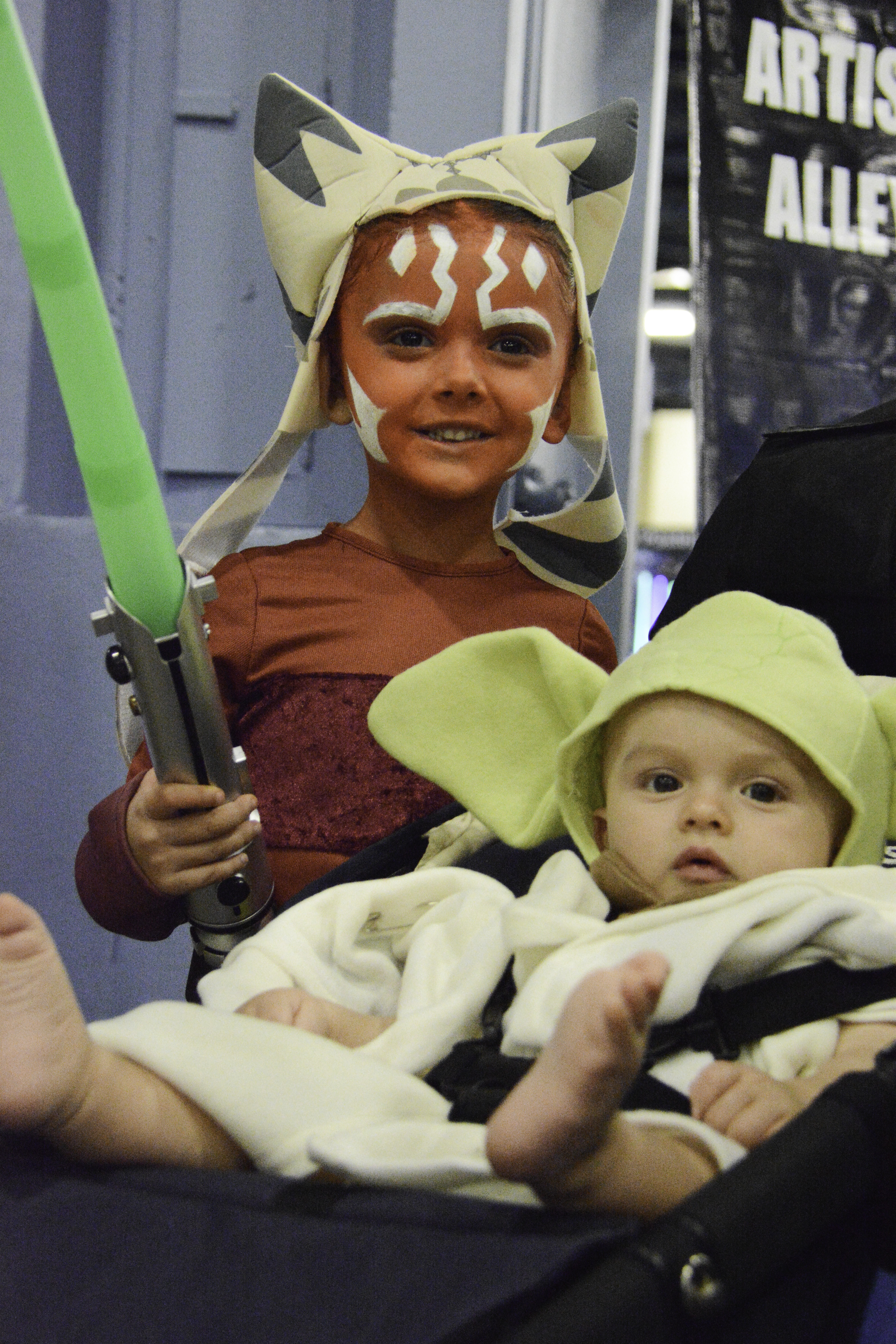 Two children dressed as Ahsoka Tano and Yoda from Start Wars.