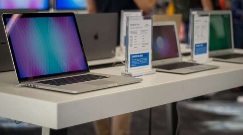 Several Apple laptops on display.