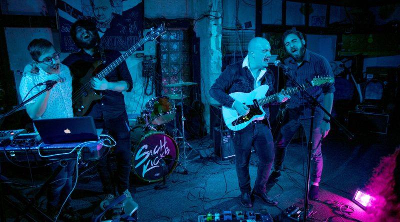 Sigh Kicks performing at their last show.