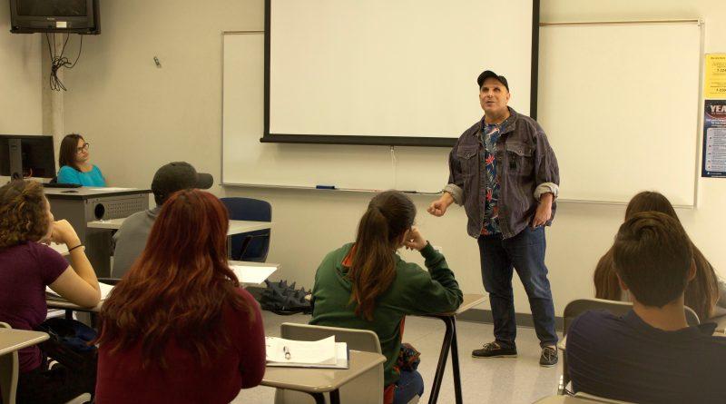 English professor Manuel Duasso giving a lecture.