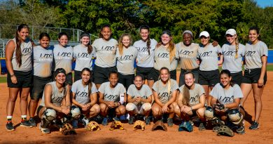 The Lady Sharks softball team posing for a picture.