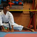 David Bavaresco stretching at a dojo.