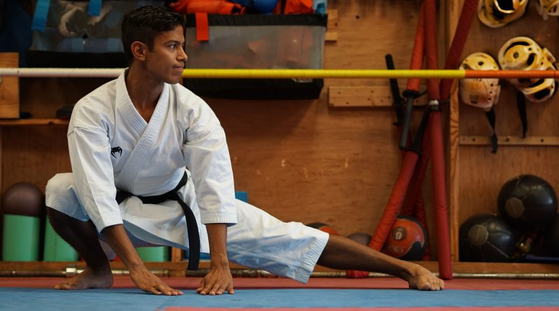 David Bavaresco stretching at a dojo.