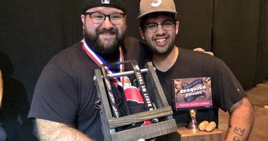 Gregory Castillo and Chris Cuan posing with their award.