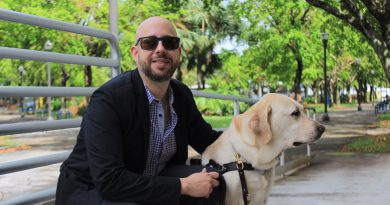 Gabriel Lopez Kafati with his guide dog, Posh at MDC North Campus.