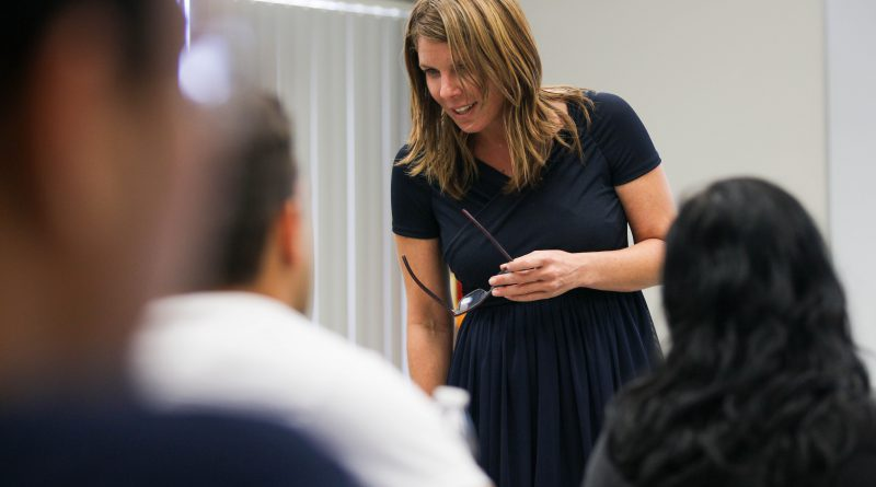 Kristen Rosen Gonzalez at one of her classes discussing about speech.