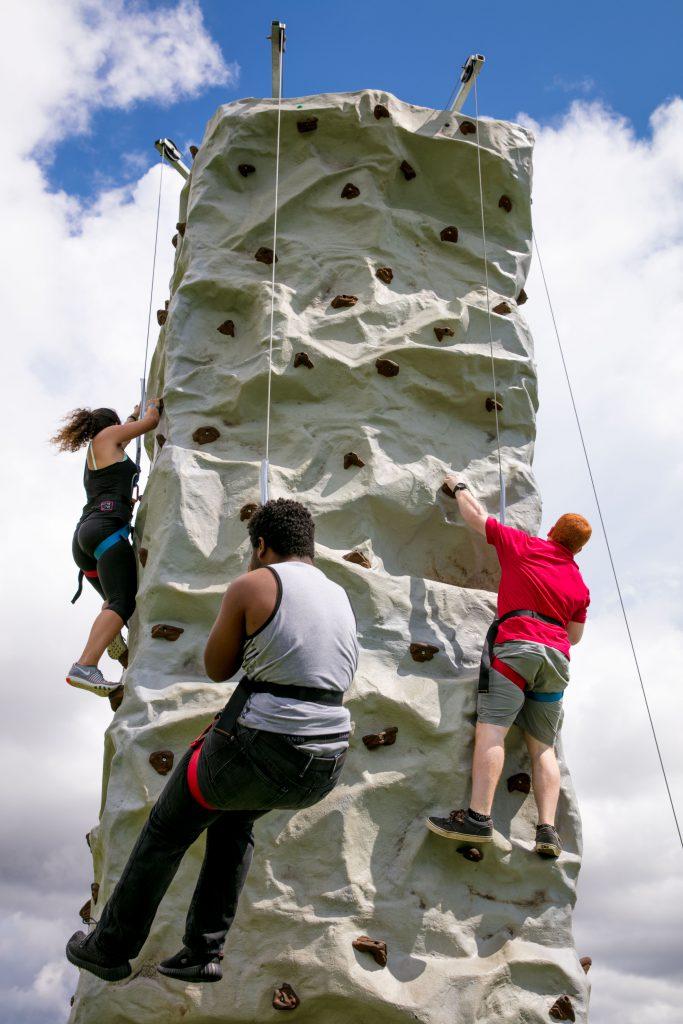 Students rock climbing.