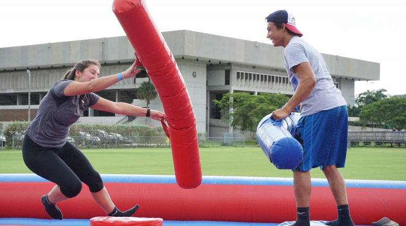 Two students sparring at Shark Fest.
