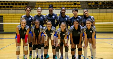 MDC's Lady Sharks volleyball team posing for the camera.