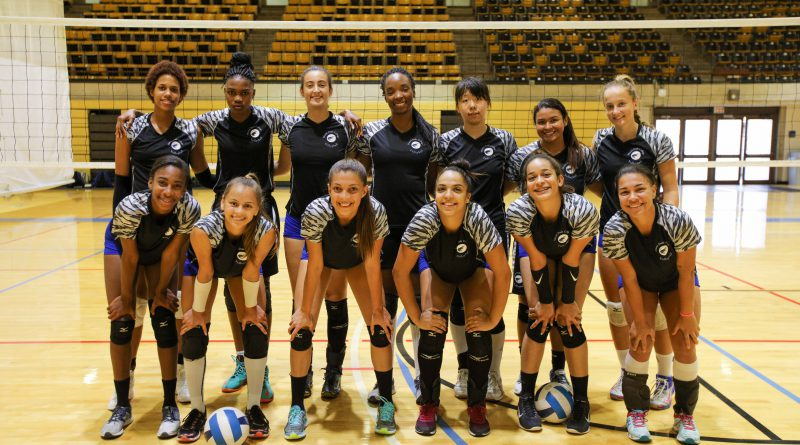 MDC Volleyball team posing for the camera.