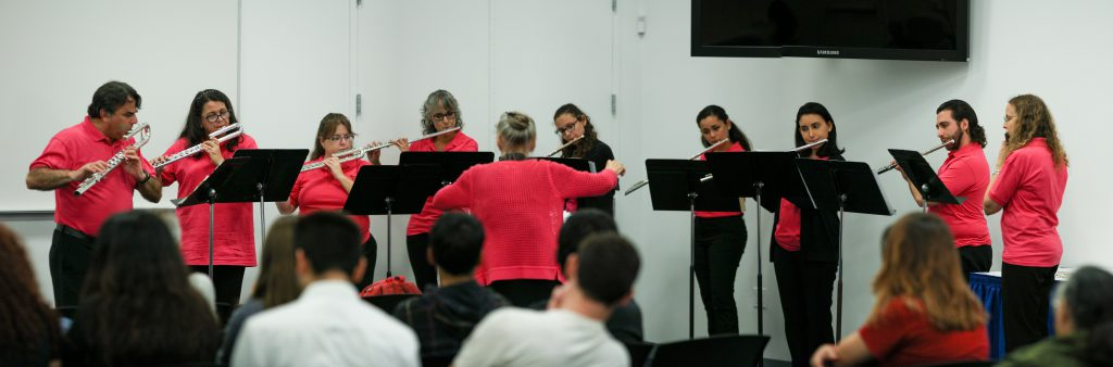 Students playing flutes.