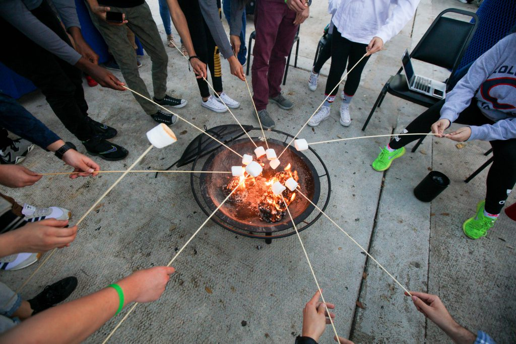 Students making s'mores.