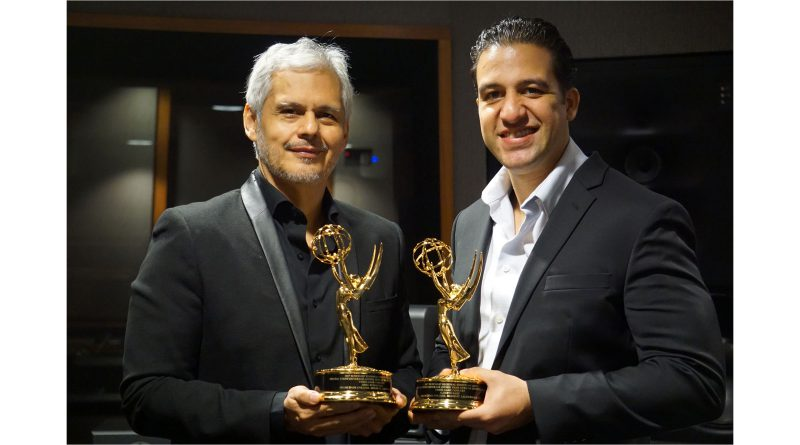 Ariel Rubalcava and Alberto Bade with their awards for MDC-TV.