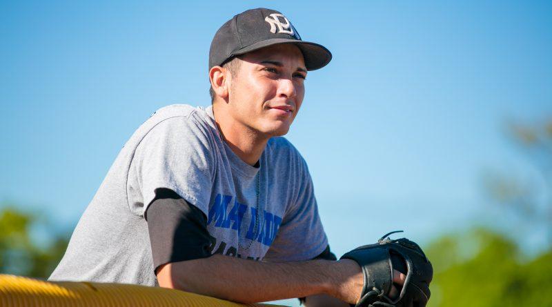 Eliezar Garcia Jr. with his glove.