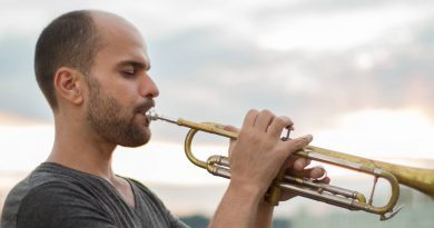 Photo of Amir ElSaffer playing the trumpet.