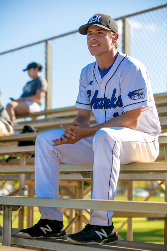 Garrett Bye sitting on the bleachers.