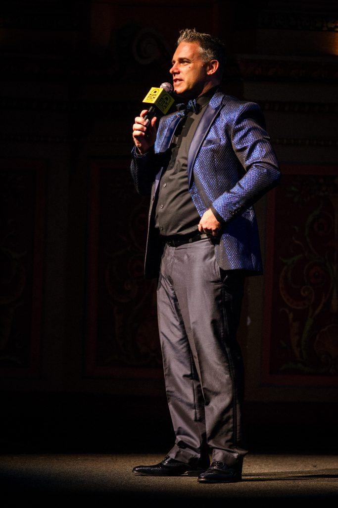 Executive director Jaie Laplante speaking on stage.