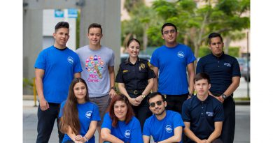 Shark Patrol students posing with Hialeah public safety chief Stephanie Fernandez.