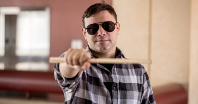 Humberto Molero posing for the camera with his drumsticks.