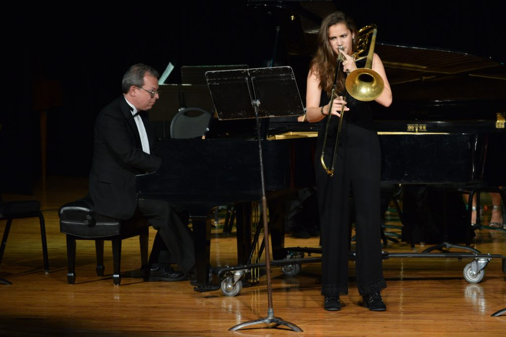Karla Gonzalez performing on stage.