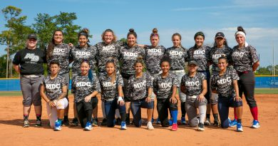 The softball team posing for a picture.