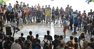 Students watching on as others dance.