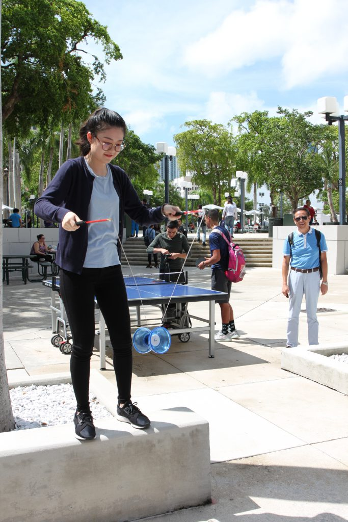 A graduate assistant playing with a diabolo, a Chinese toy similar to a yo-yo.