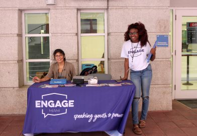 Two volunteers at the table waiting to help students.