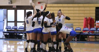 MDC's Lady Sharks volleyball team celebrating.
