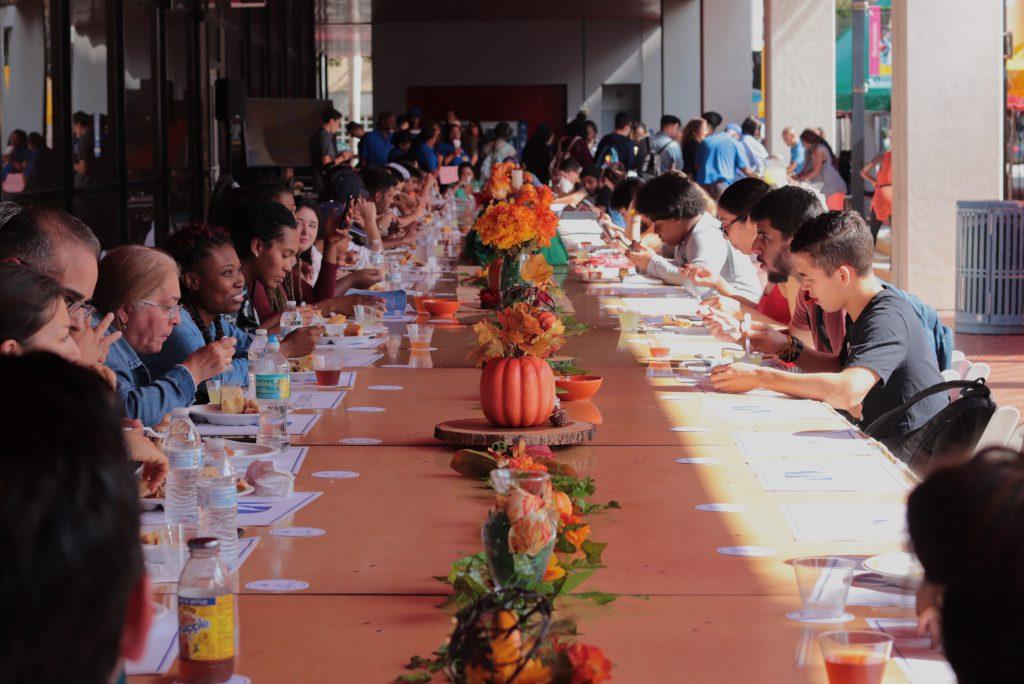 Students having Thanksgiving dinner.