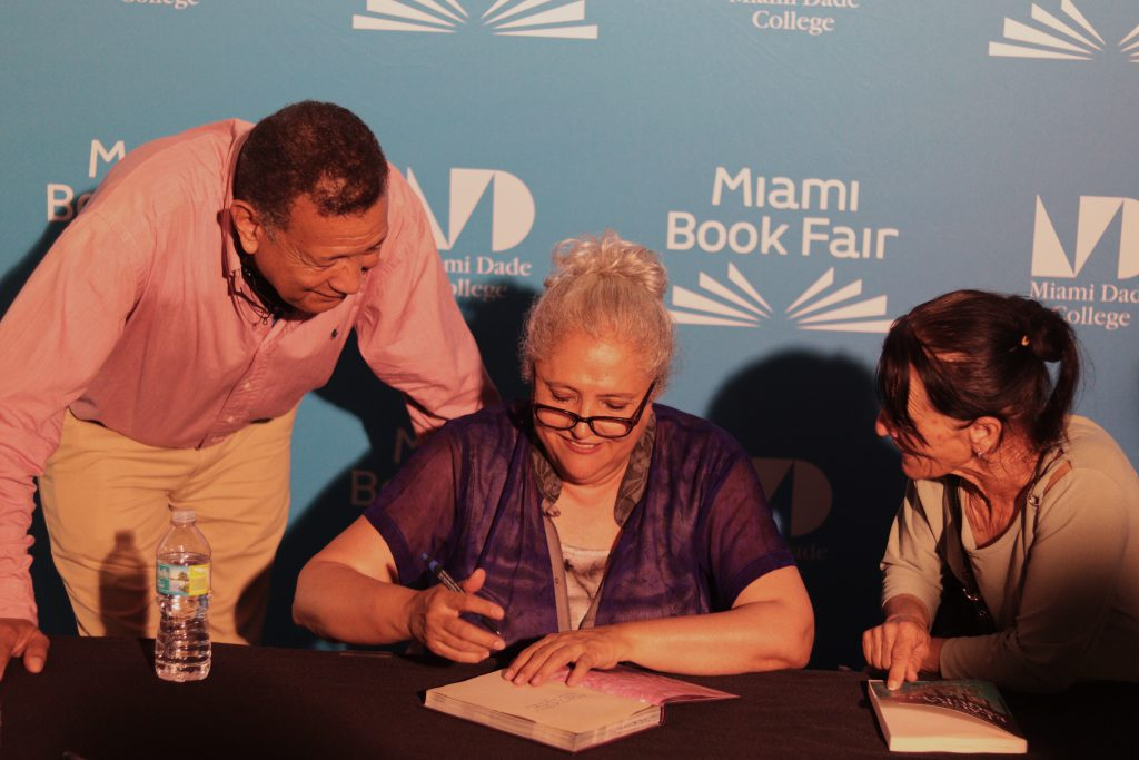 Author Laura Esquivel signing a book.