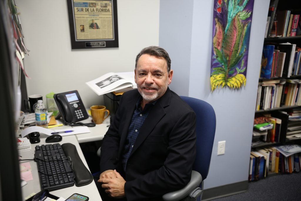 Alejandro Rios at his desk.
