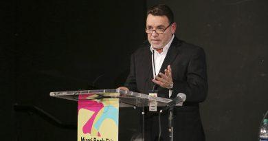 Photo of Alejandro Rios at a podium.