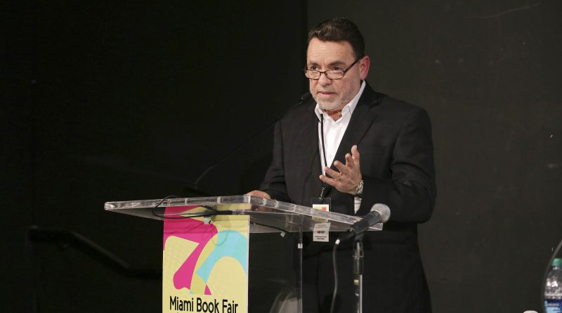 Photo of Alejandro Rios at a podium.