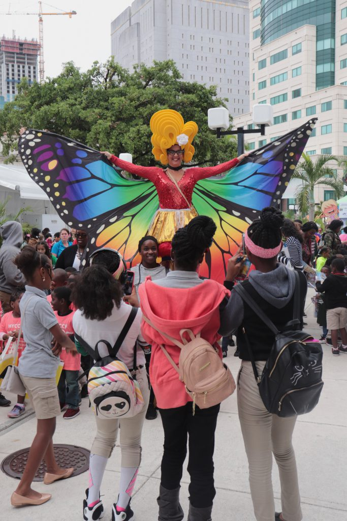 Street performer dressed as a butterfly.